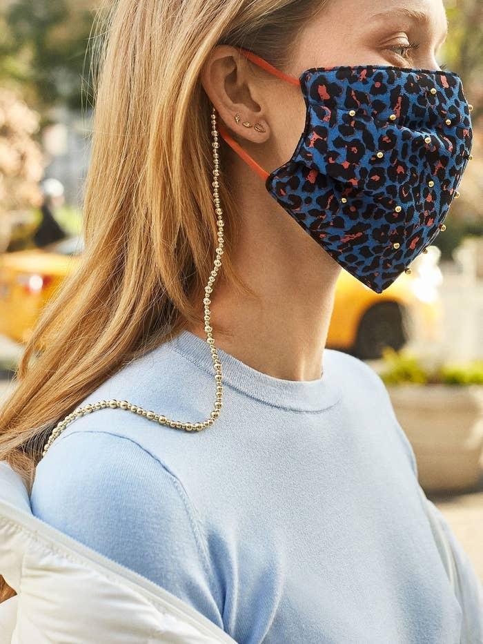 Model wearing Baublebar face mask chain