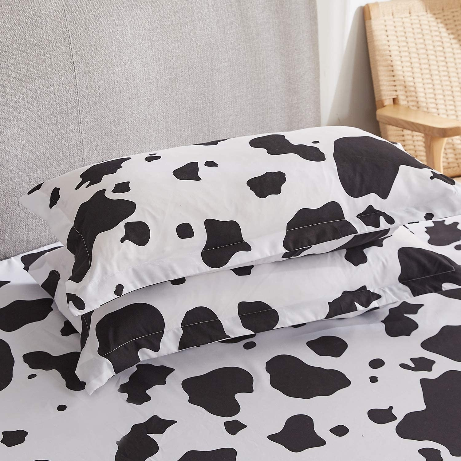 The cow print bed sheets on a bed