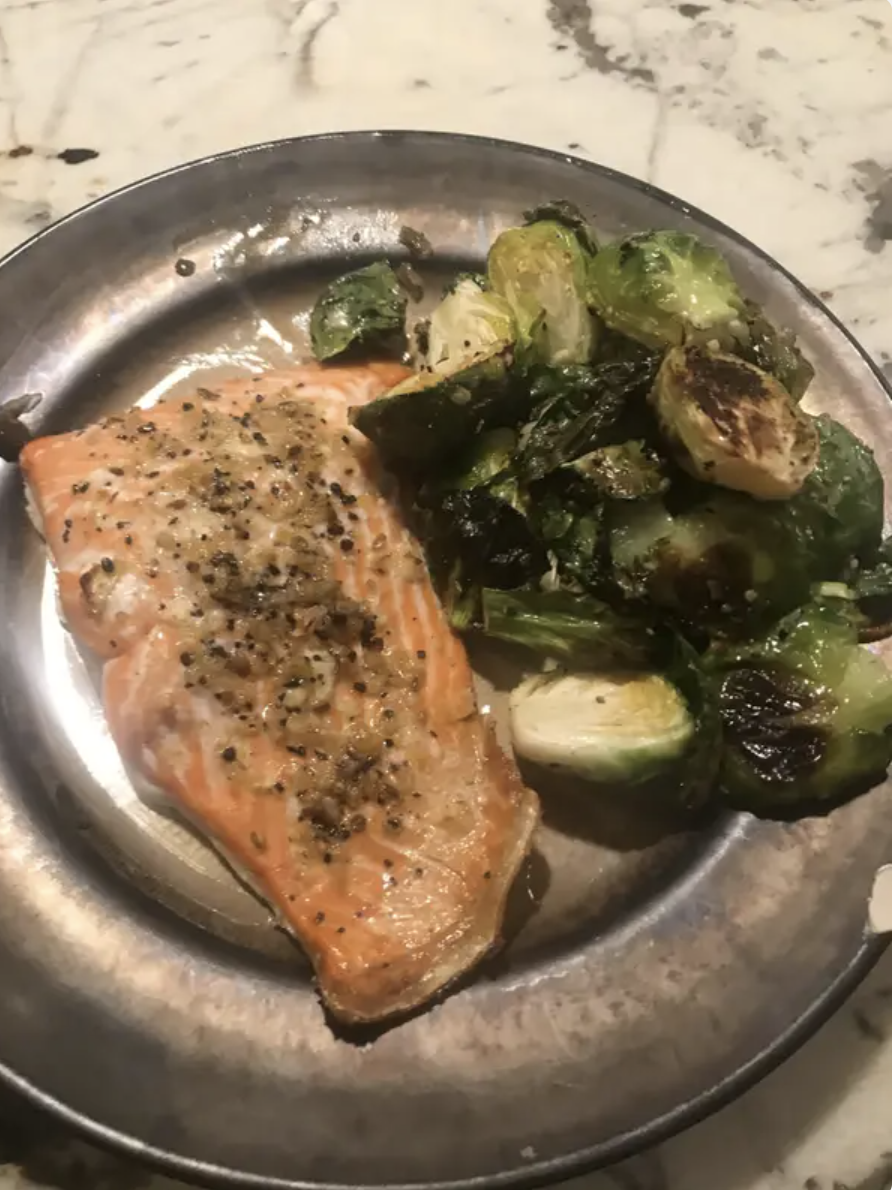 A dinner plate of salmon and Brussels sprouts