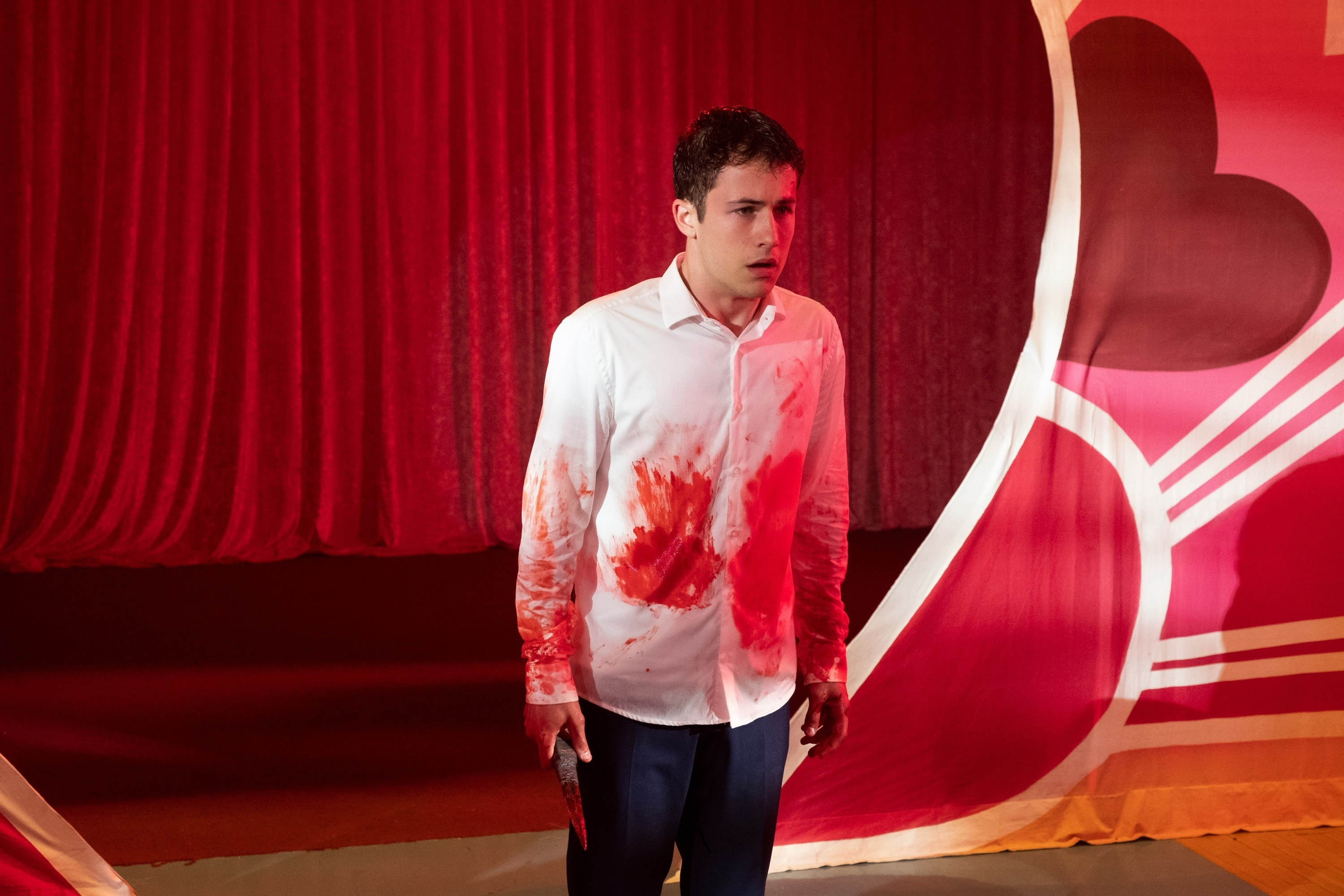 Clay with blood on his shirt