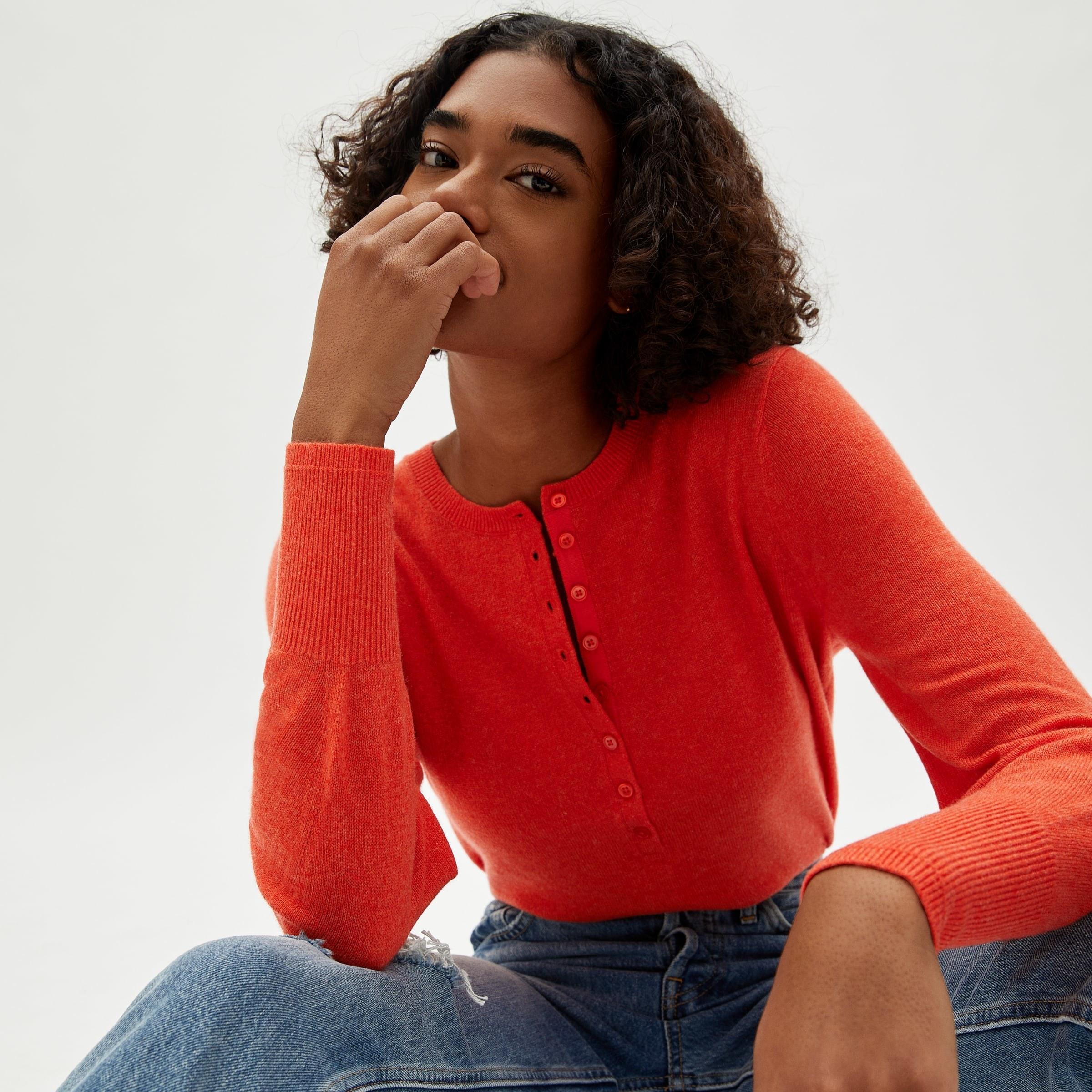 Model in the red-orange henley
