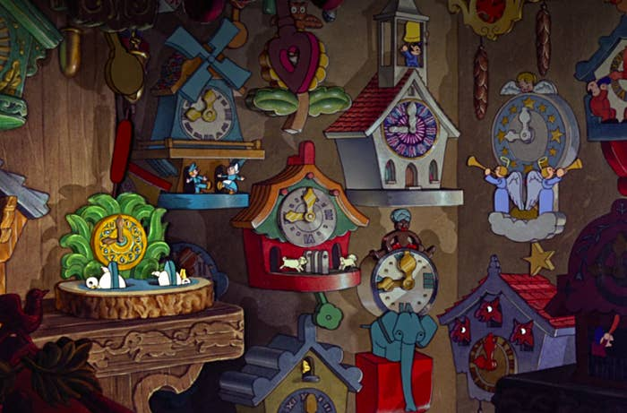 several impossible-looking cuckoo clocks hang on the workshop wall
