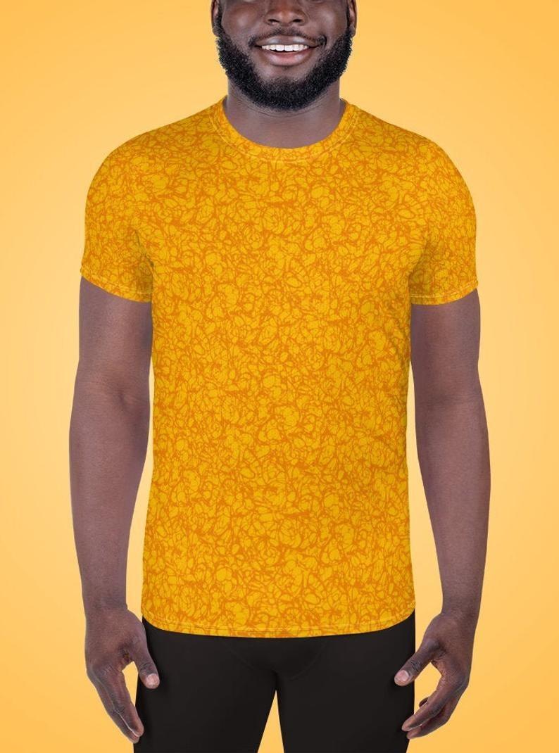 a model wearing the golden yellow shirt