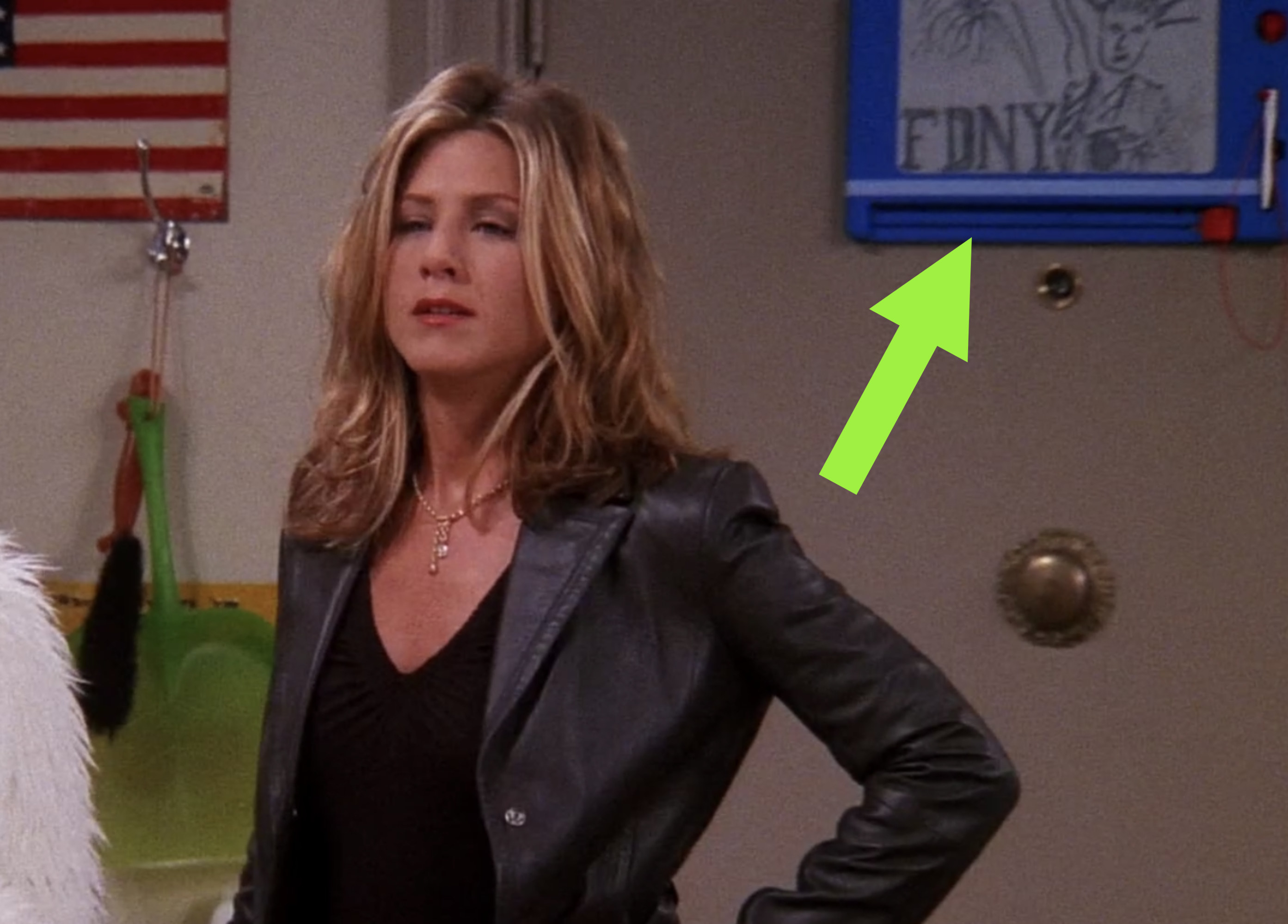 "behind Rachel there's an etch-a-sketch with a drawing of the statue of liberty and the words ""FDNY"" on it"