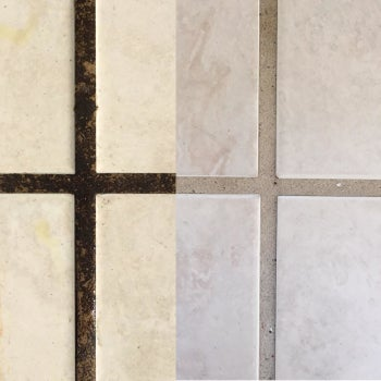 reviewer's up close picture of dirty grout next to clean grout