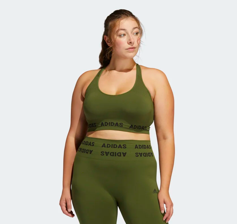 a model wearing the green sports bra with matching leggings