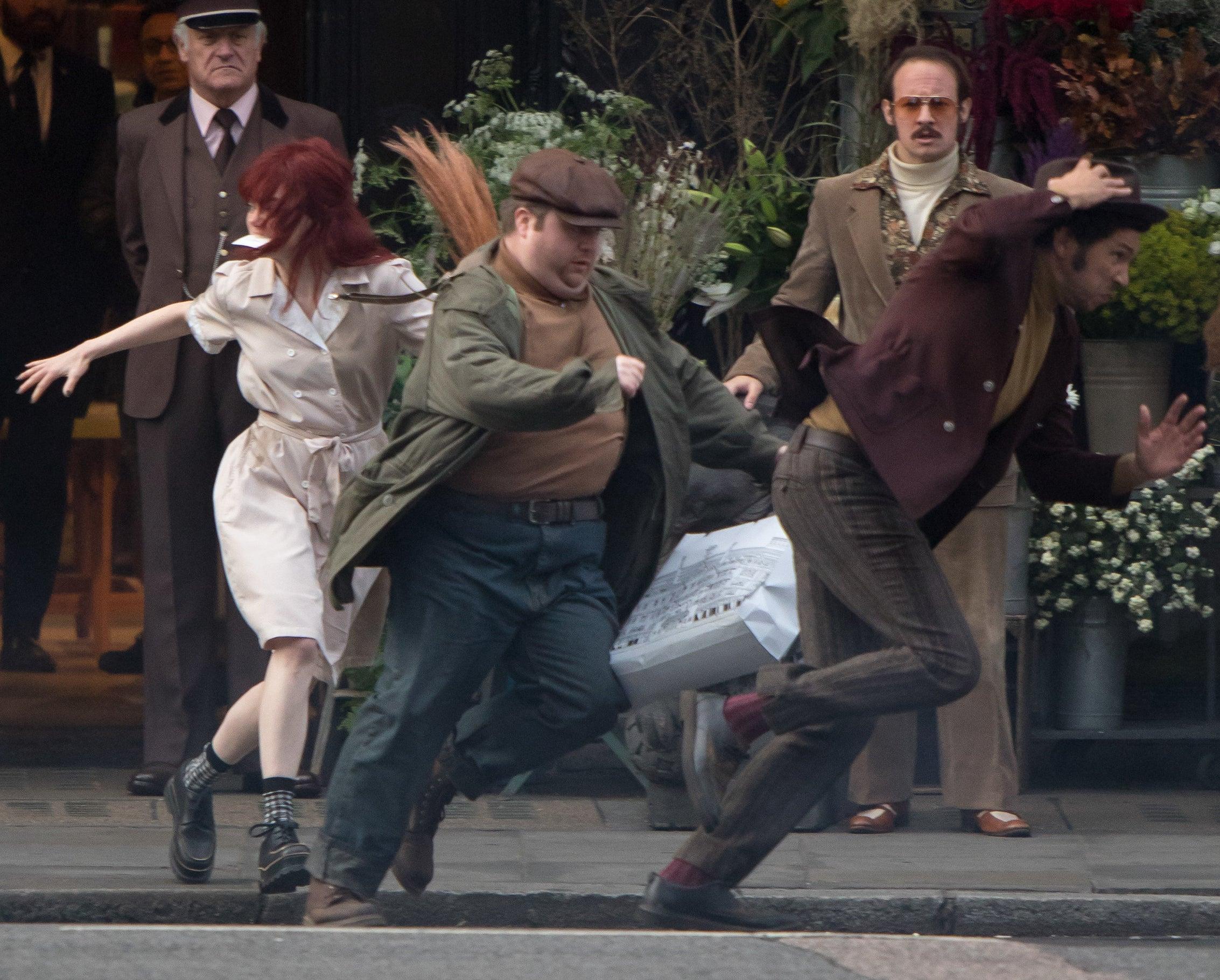 Emma Stone on set filming Cruella