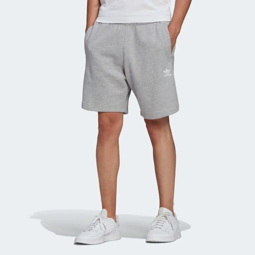 The grey shorts worn by a model and paired with white sneakers