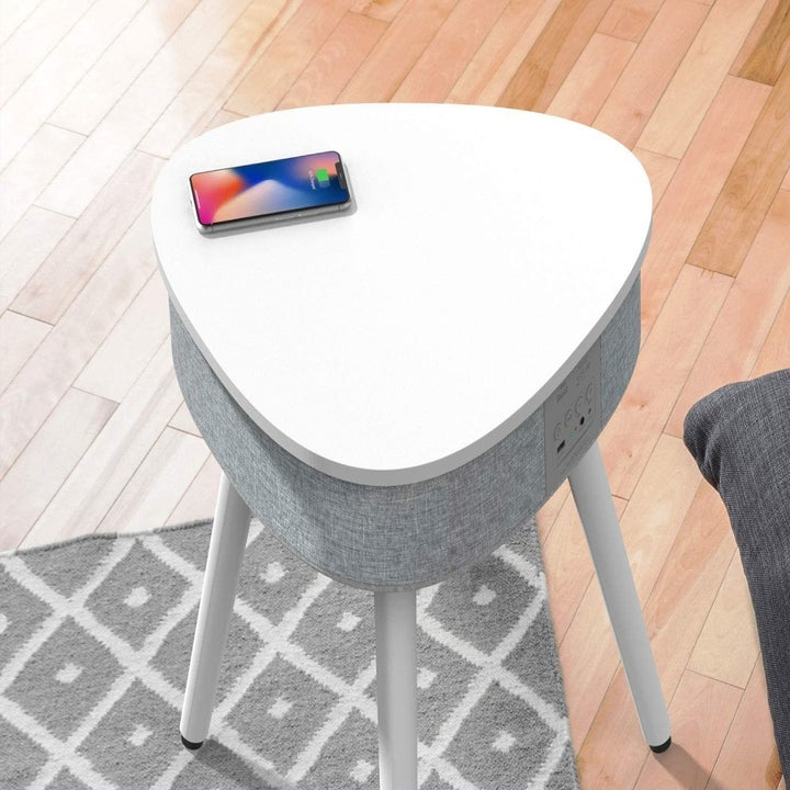 The table with a phone placed on the top, charging