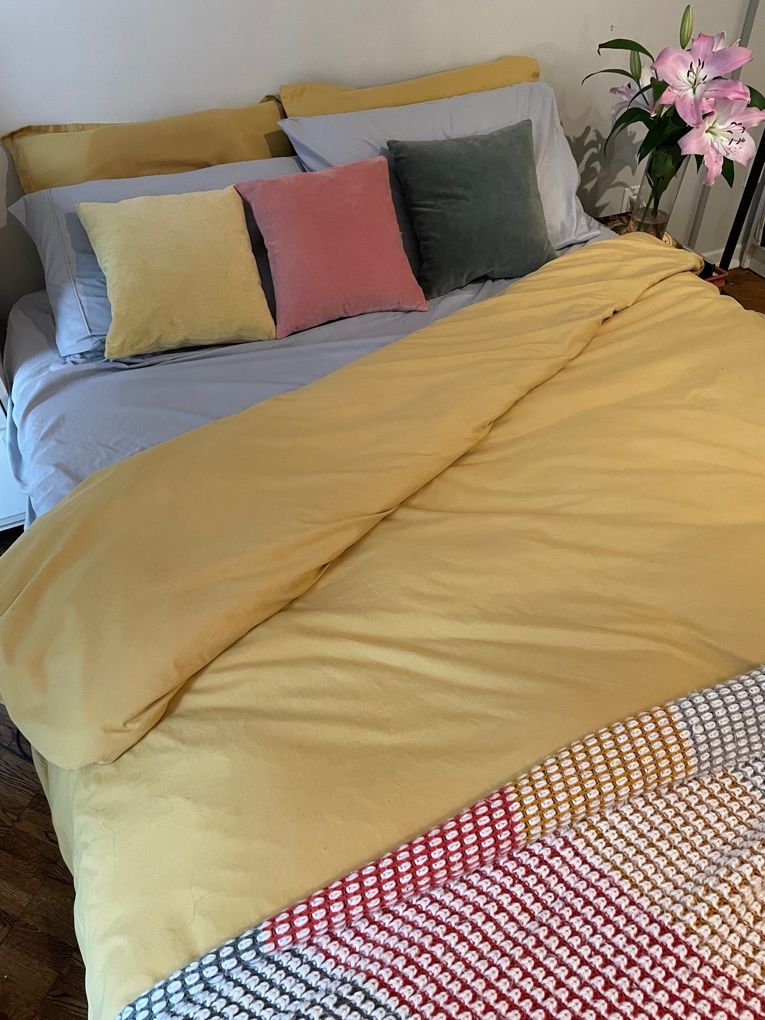 A cozy bed showing off the duvet and pillows