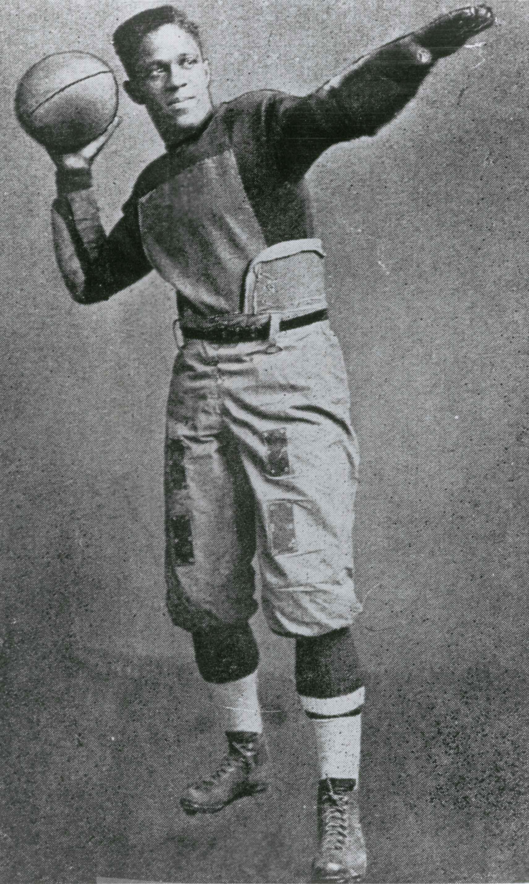 Fritz Pollard throwing football