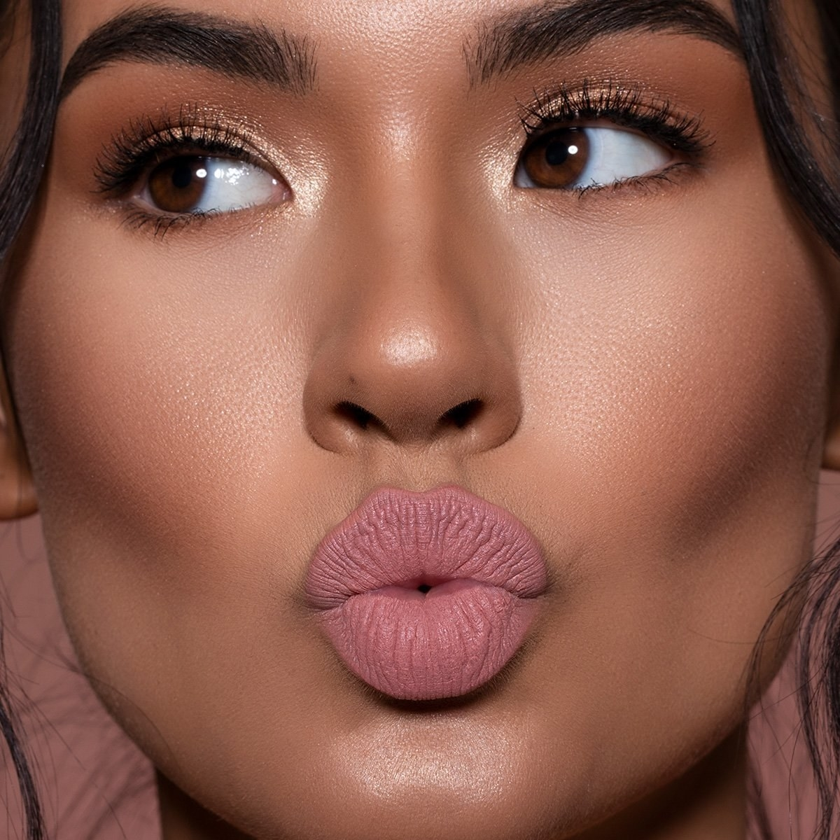 Model wearing a matte nude pink shade