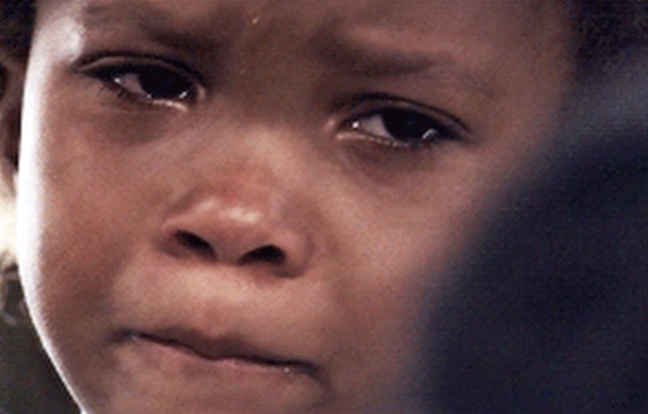 Little girl looking like she's about to cry.