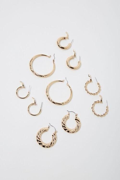 Five sets of gold hoop earrings in various styles
