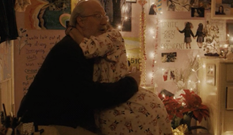 Daughter hugging her dad.