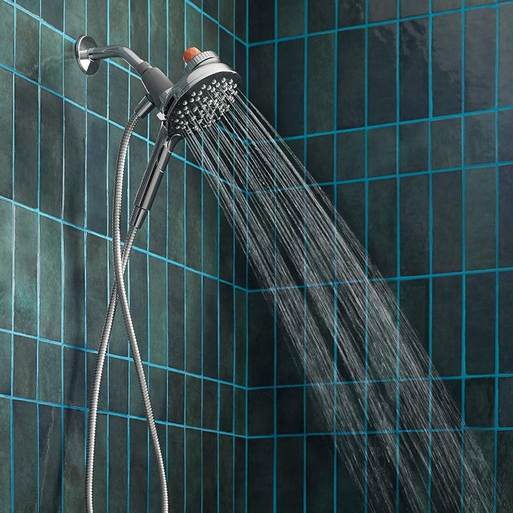 The showerhead with water flowing out of it