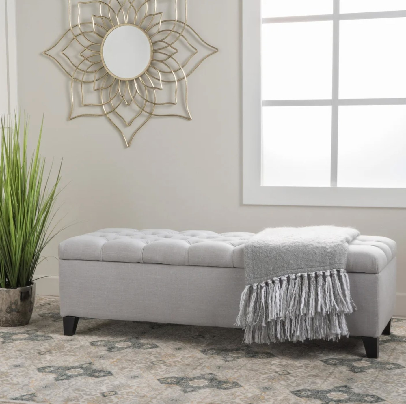 The ottoman bench in light gray