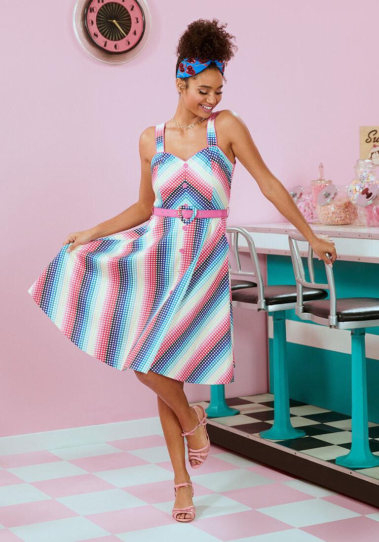 A model wearing the swing dress