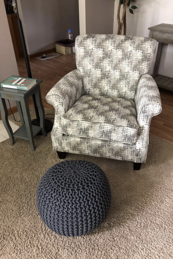 ottoman used as foot rest with armchair