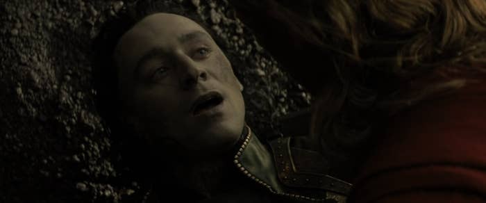 """Loki gasping while Thor looks over him in """"Thor: The Dark World"""""""