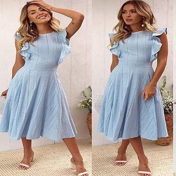 A model wearing the dress in blue