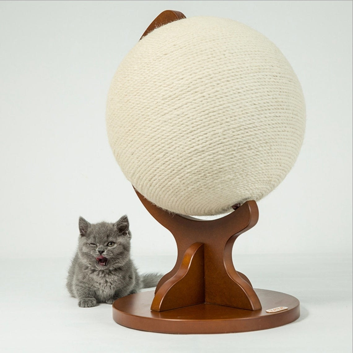 Globe shaped cat scratcher with wooden base and scratch-able orb