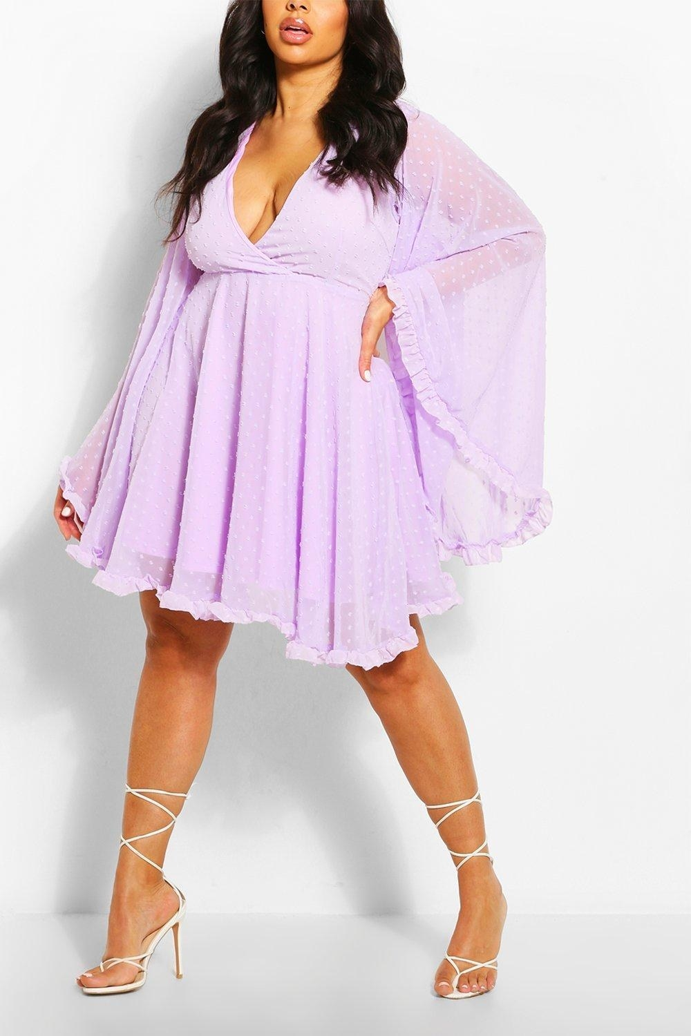 A model wearing the skater dress in lilac