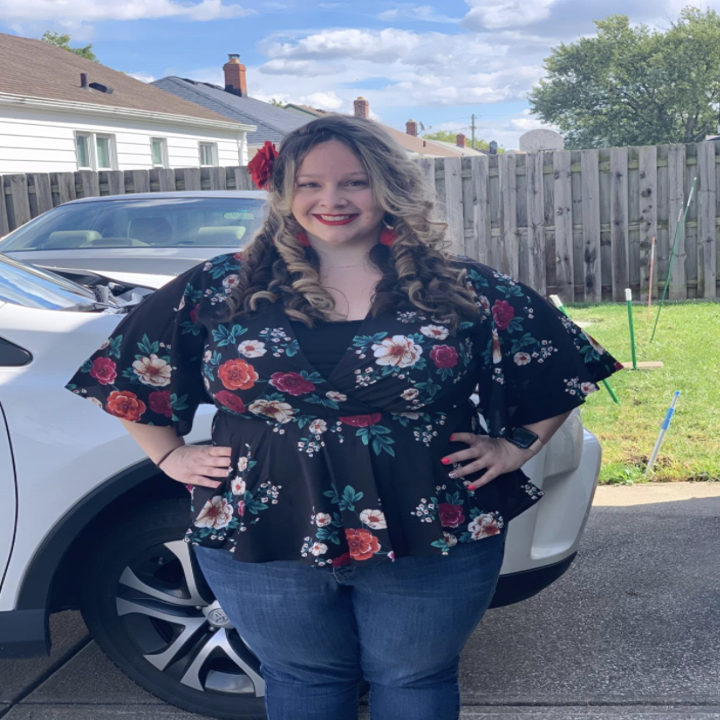 reviewer wears floral top in black