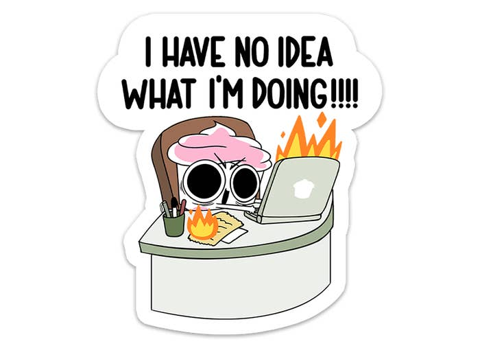 """Sticker of Cuppy sitting at a desk with a laptop and notes on fire with text that says """"I have no idea what I'm doing"""""""