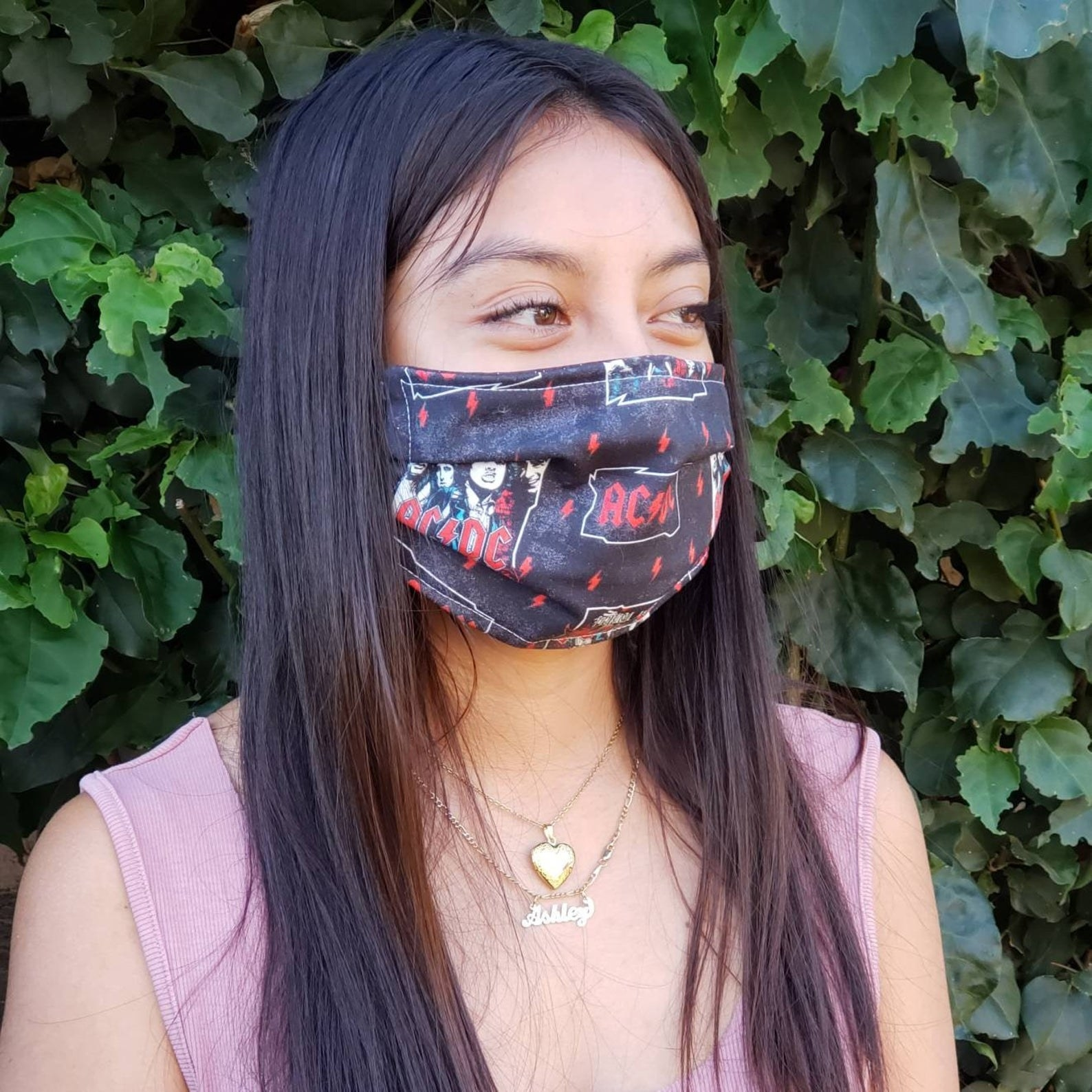 A model in an AC/DC face mask