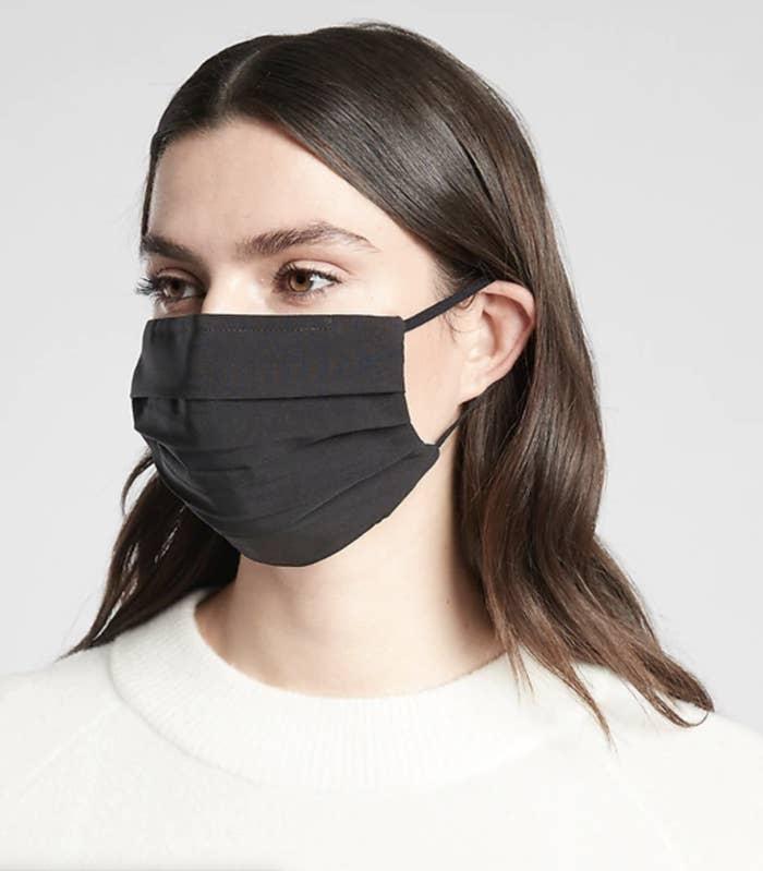 Model in a black face mask