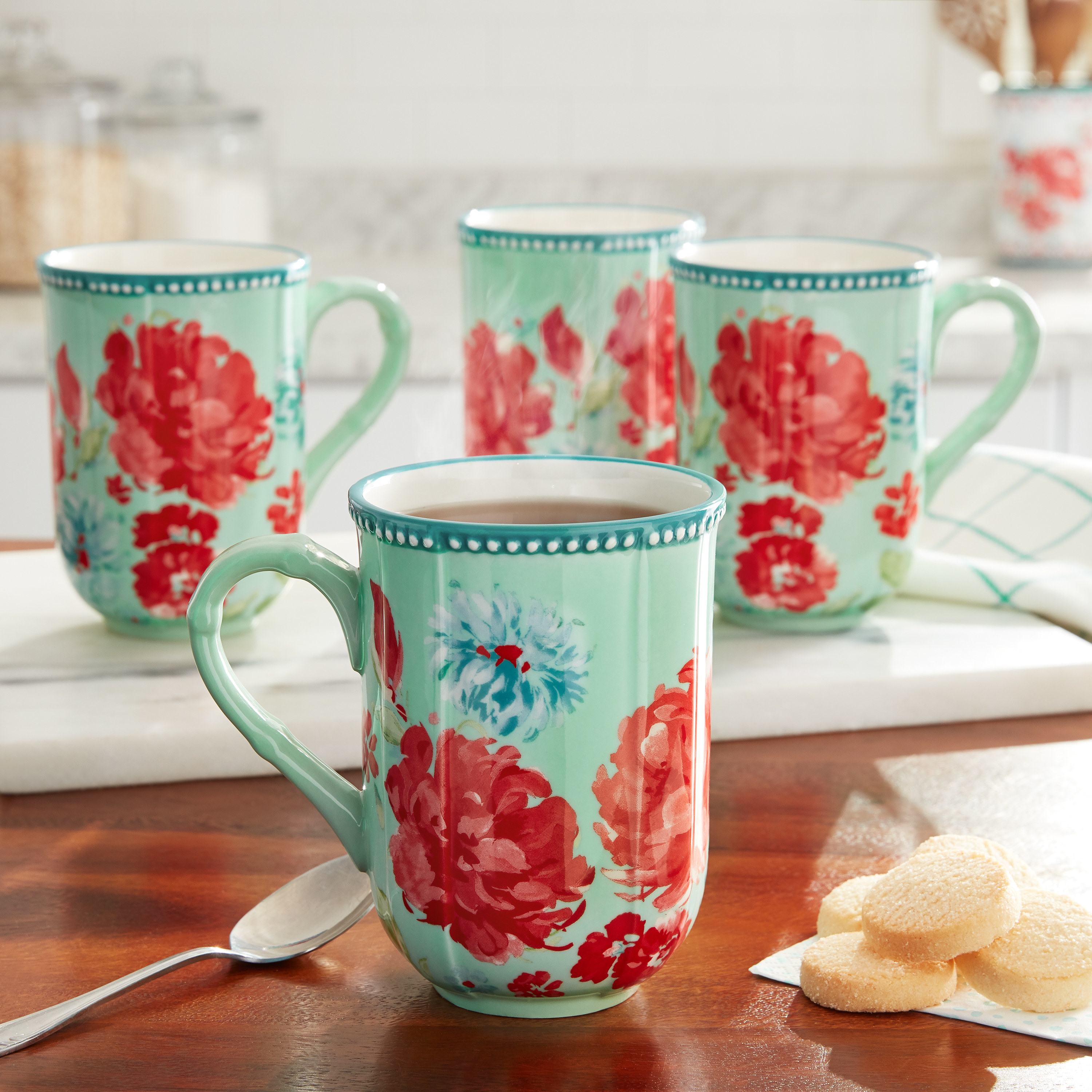 the mugs with red and blue flowers on them