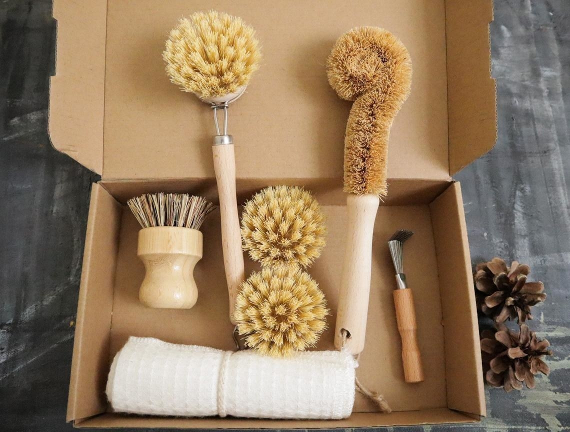 A cardboard box with bamboo tools and towels
