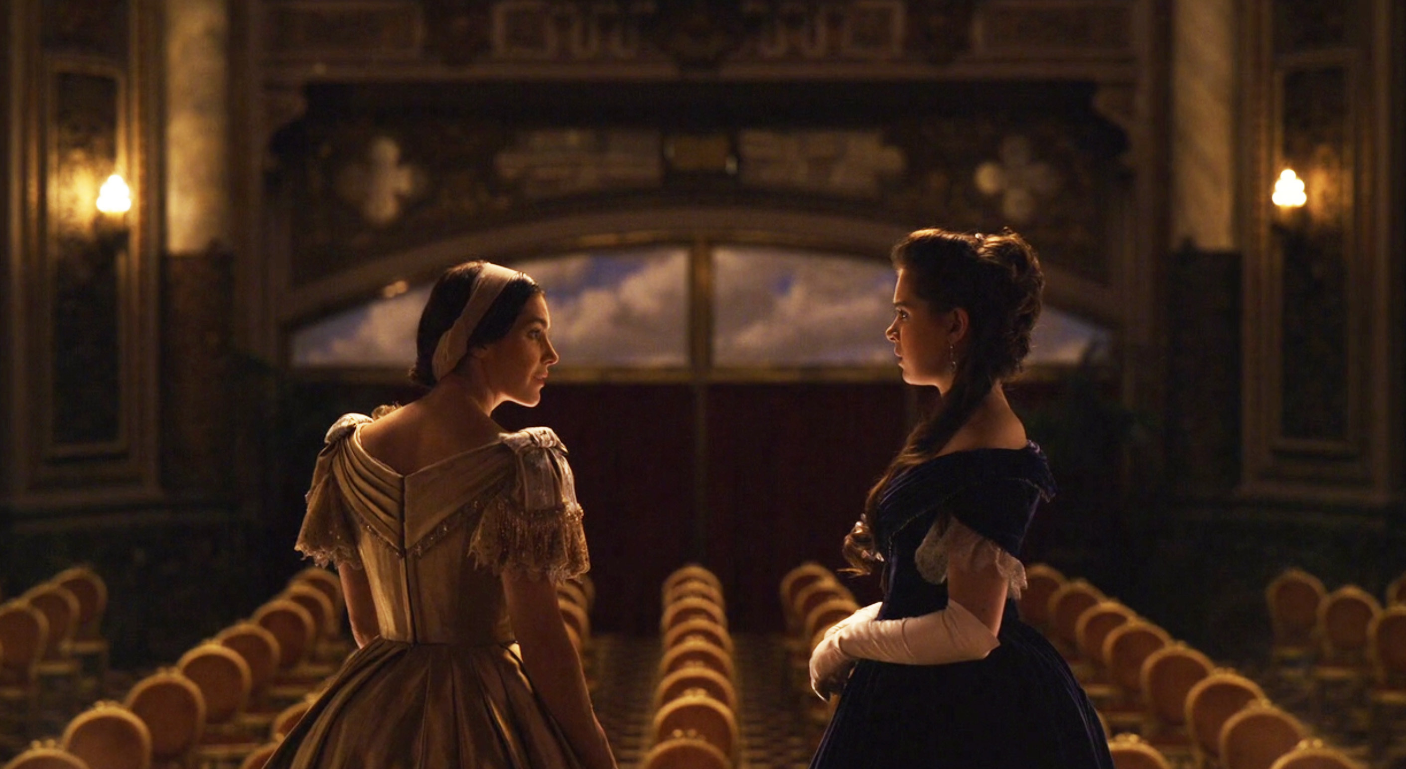Hailee Steinfeld as Emily in Dickinson standing on the stage at the opera