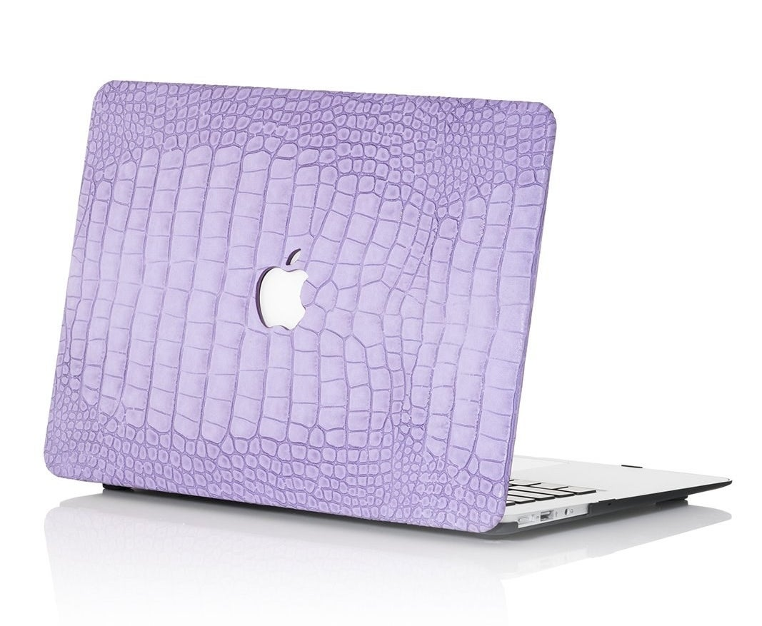 laptop with the lilac case on the back of the monitor