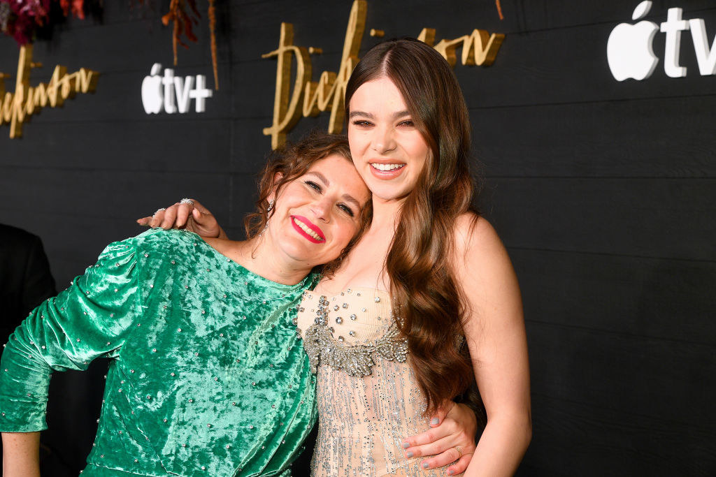 Dickinson creator Alena Smith hugging Hailee Steinfeld on a red carpet
