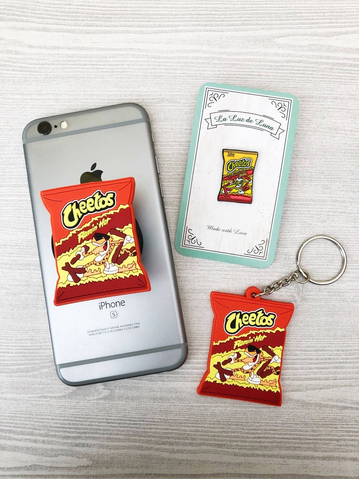 Phone grip that looks like a bag of Flamin' Hot Cheetos