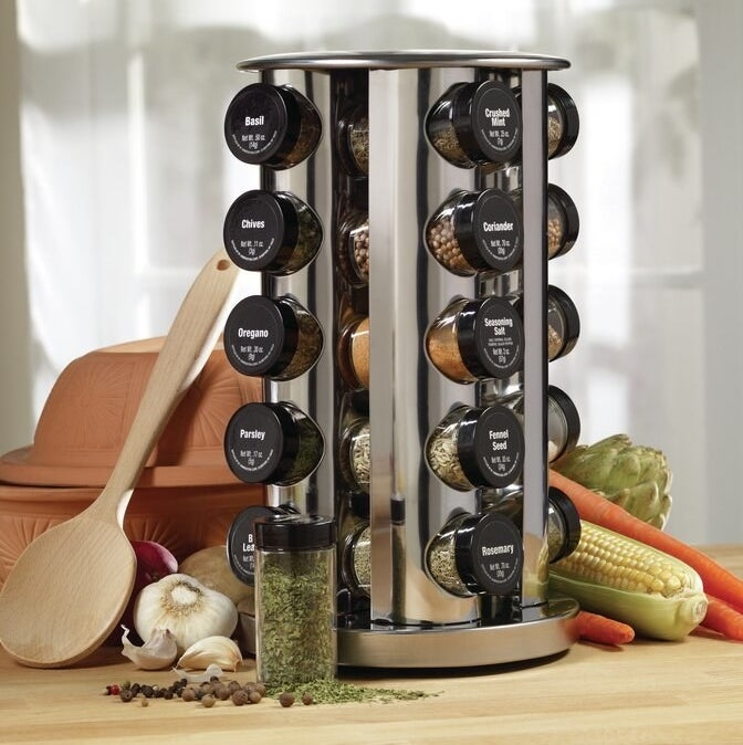 the spice rack filled with the various spice jars