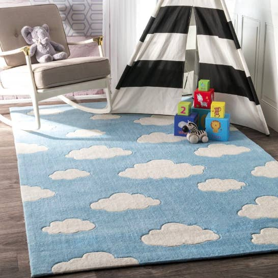 blue rug with white clouds