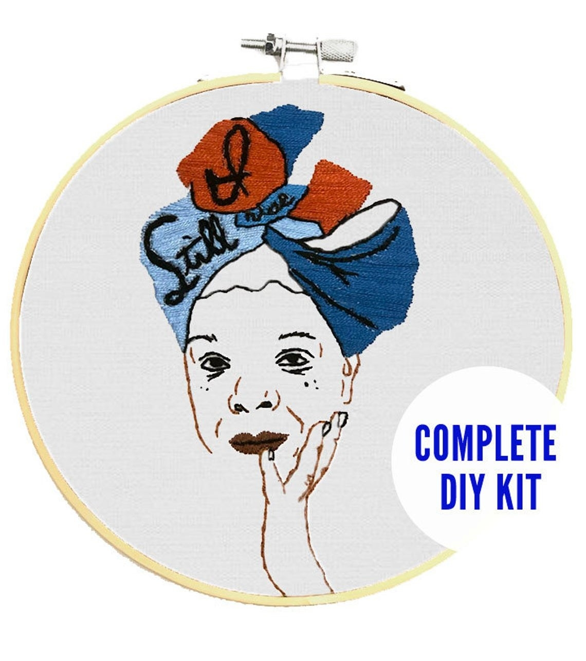 """the Maya Angelou embroidery kit showing Maya's face and the words """"Still I rise"""""""