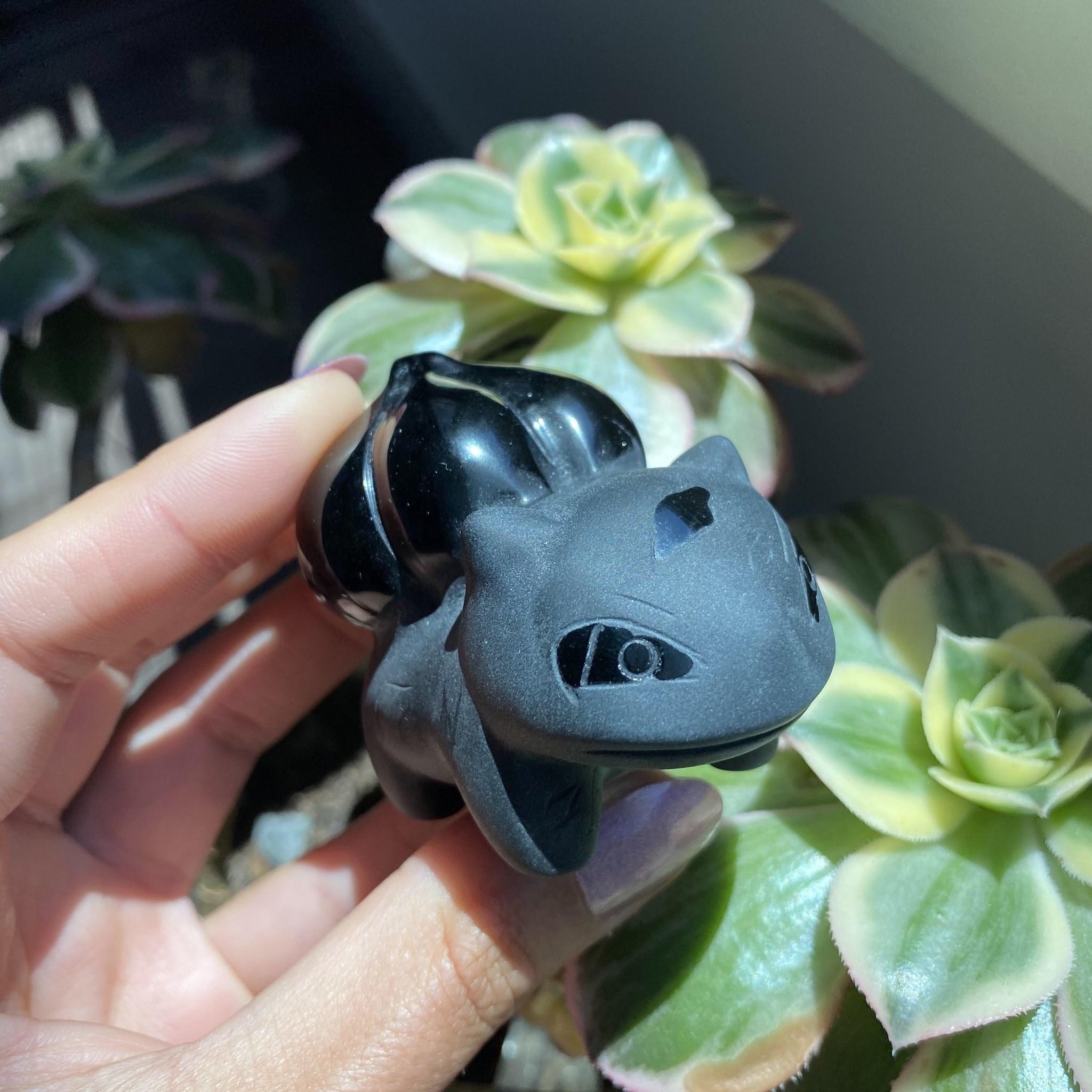 bulbasaur shaped black stone