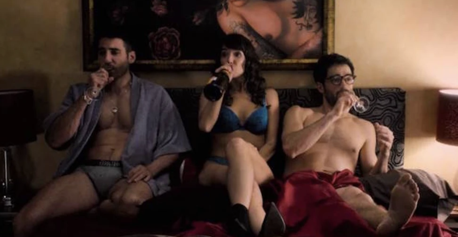 "Lito and Hernando and Daniela on a bed together in ""Sense8"""