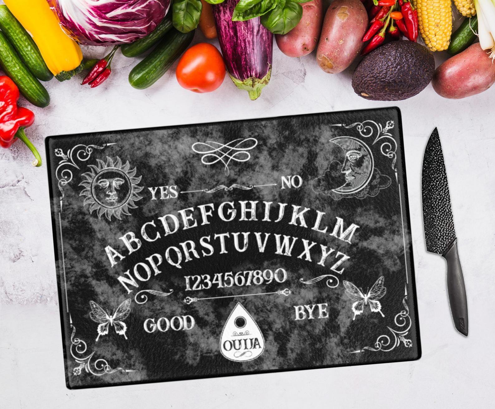 the black cutting board that looks like a ouija board
