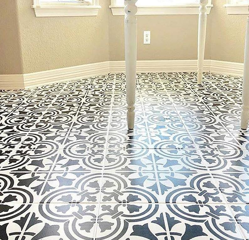 white tile that has been painted with the stencil in black