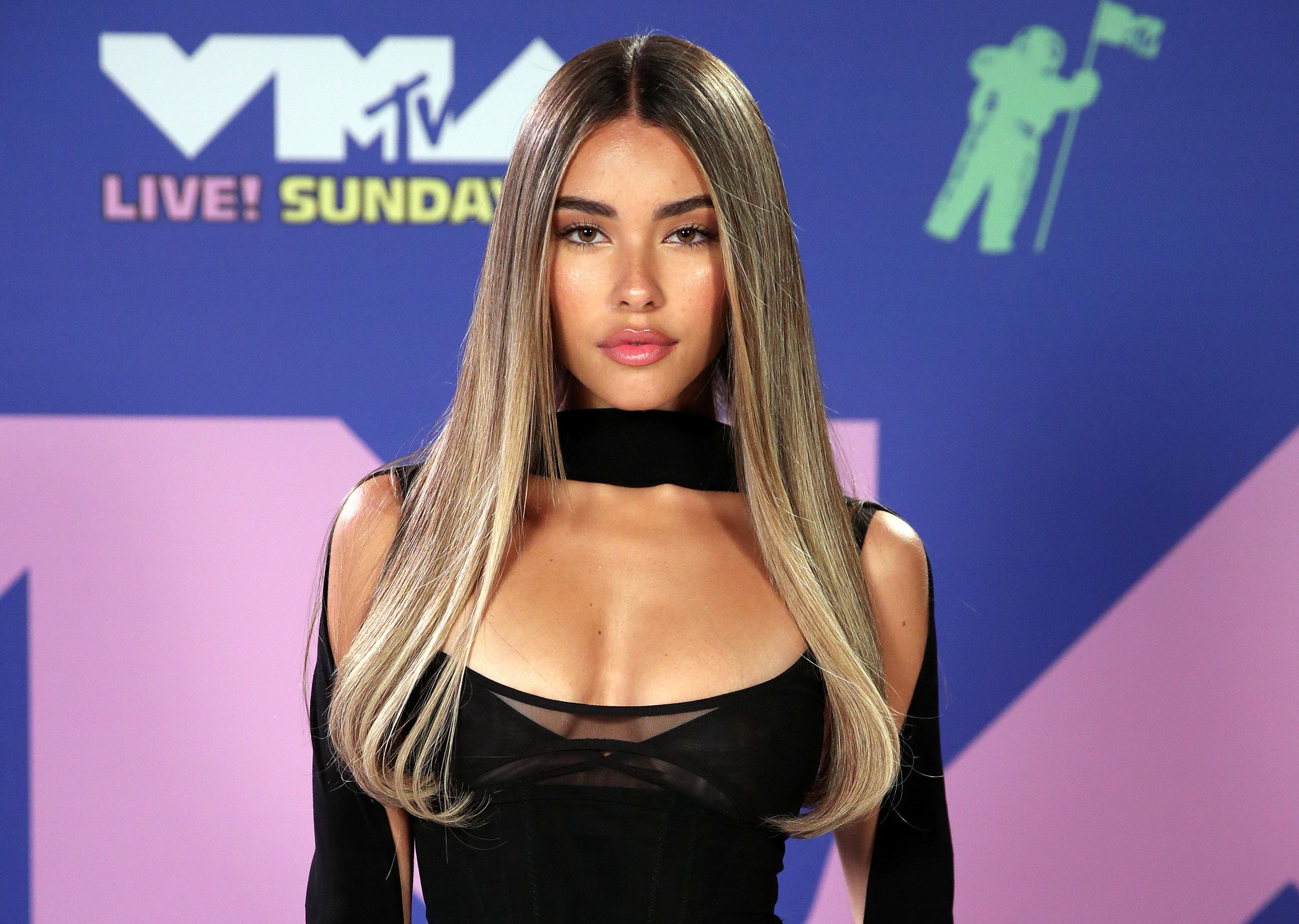 Madison in a black off-the-shoulder dress on a red carpet