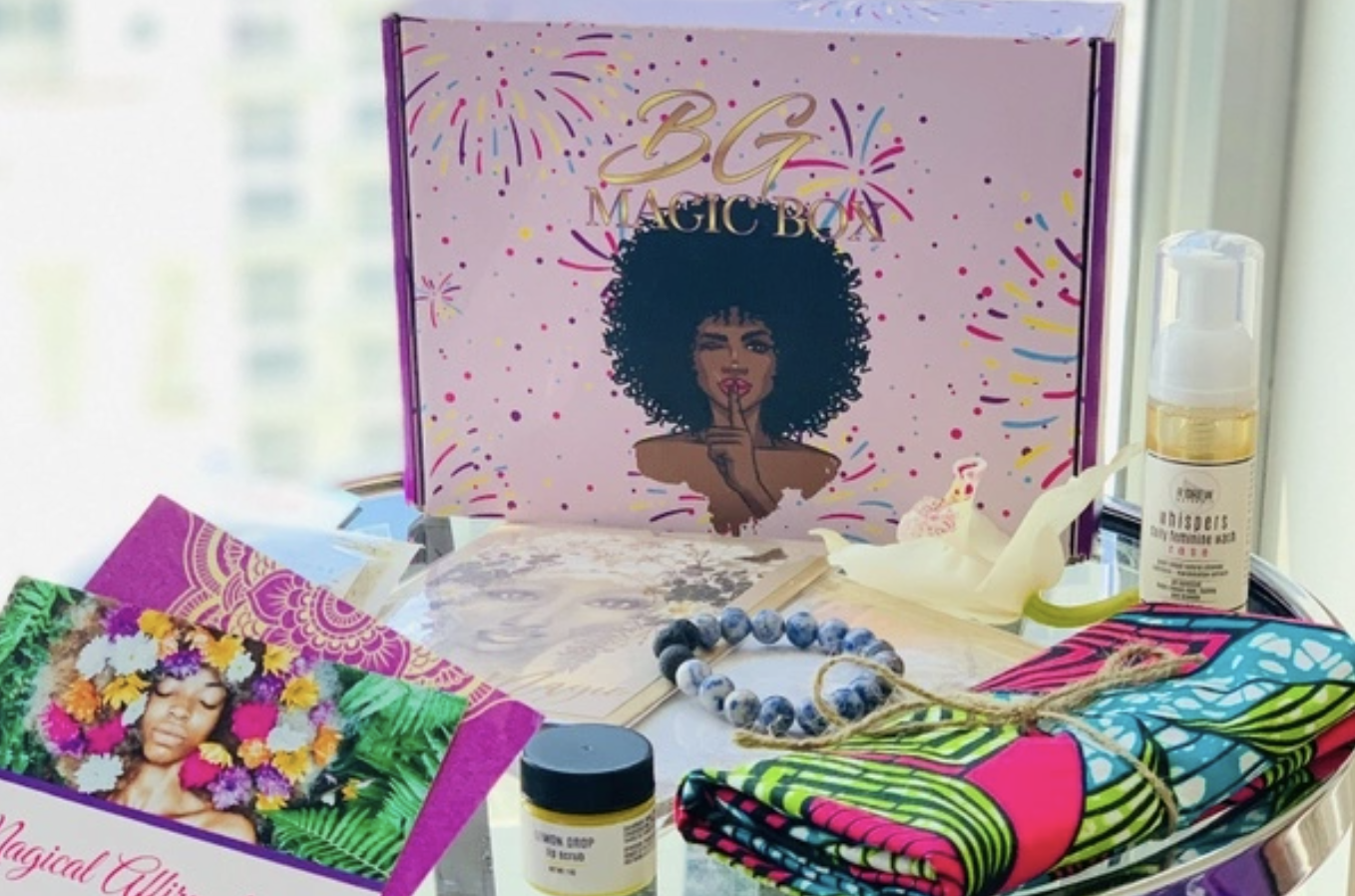 the contents of a black girl magic box on a table