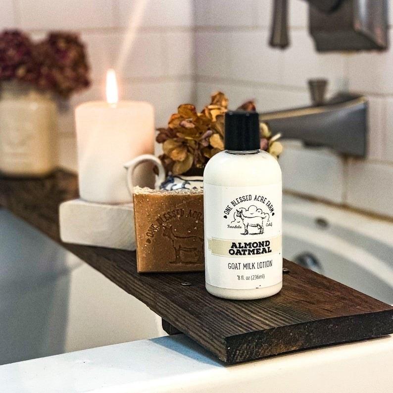 bottle of lotion styled on bathtub ledge