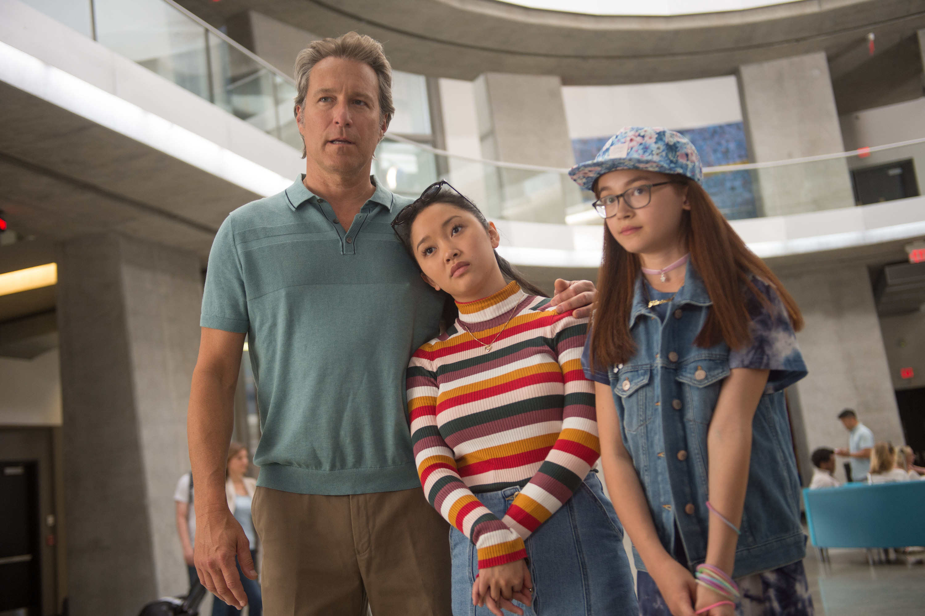 Lana Condor stands in between John Corbett and Anna Cathcart in To All the Boys I've Loved Before