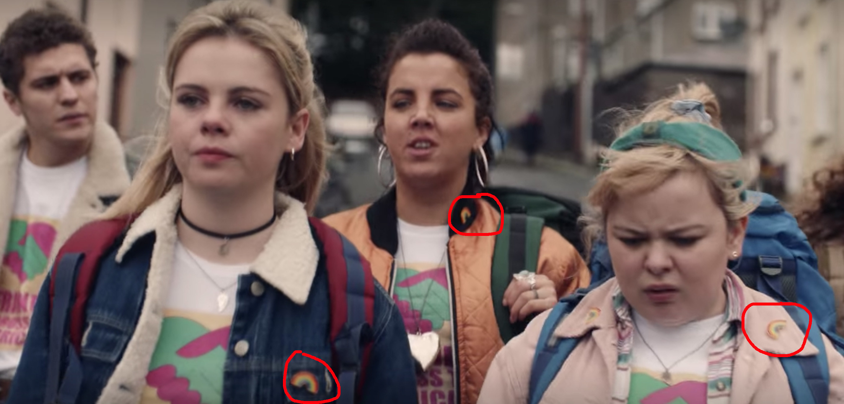 The Derry Girls all wearing rainbow pins