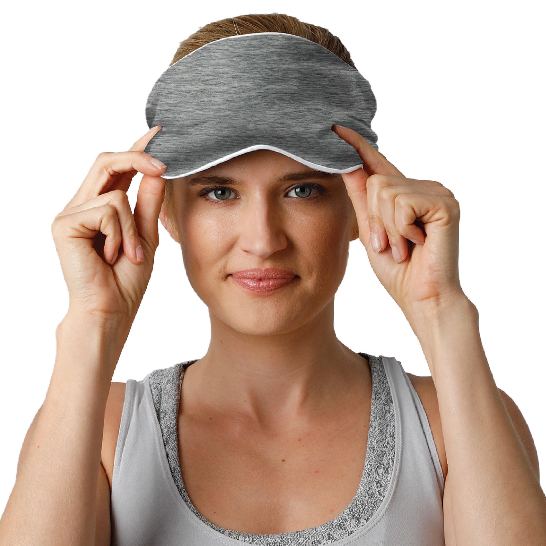 a model wearing the eye mask in gray